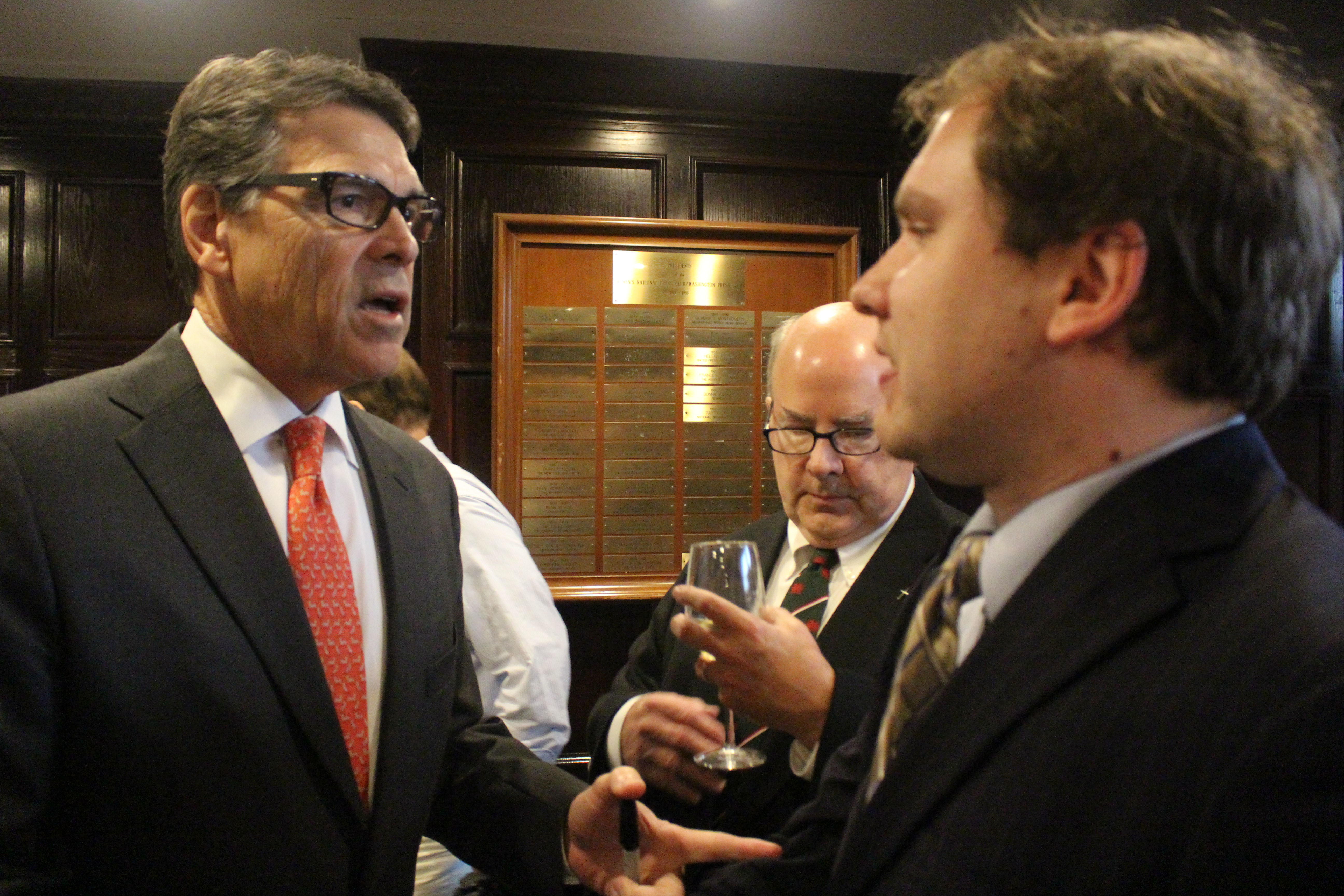 Former Texas Gov. Rick Perry speaking with RespectAbility Fellow James Trout at the National Press Club in Washington, D.C. on July 2, 2015.