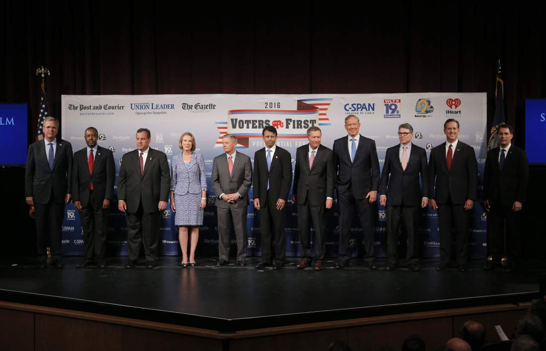 Eleven of the declared 2016 Republican U.S. presidential candidates, including (L-R) Florida Gov. Jeb Bush, Dr. Ben Carson, New Jersey Governor Chris Christie, former Hewlett-Packard CEO Carly Fiorina, U.S. Senator Lindsey Graham, Louisiana Governor Bobby Jindal, Ohio Governor John Kasich, former New York Governor George Pataki, former Texas Governor Rick Perry, former U.S. Senator Rick Santorum and Wisconsin Governor Scott Walker, pose together on stage before the start of the the Voters First Presidential Forum in Manchester, New Hampshire, August 3, 2015. REUTERS/Brian Snyder - RTX1MX1K