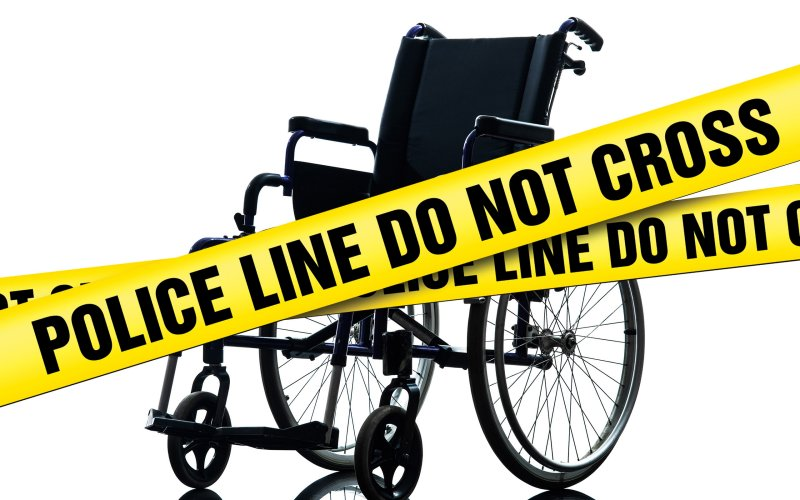 Image: Police caution tape in front of a wheelchair