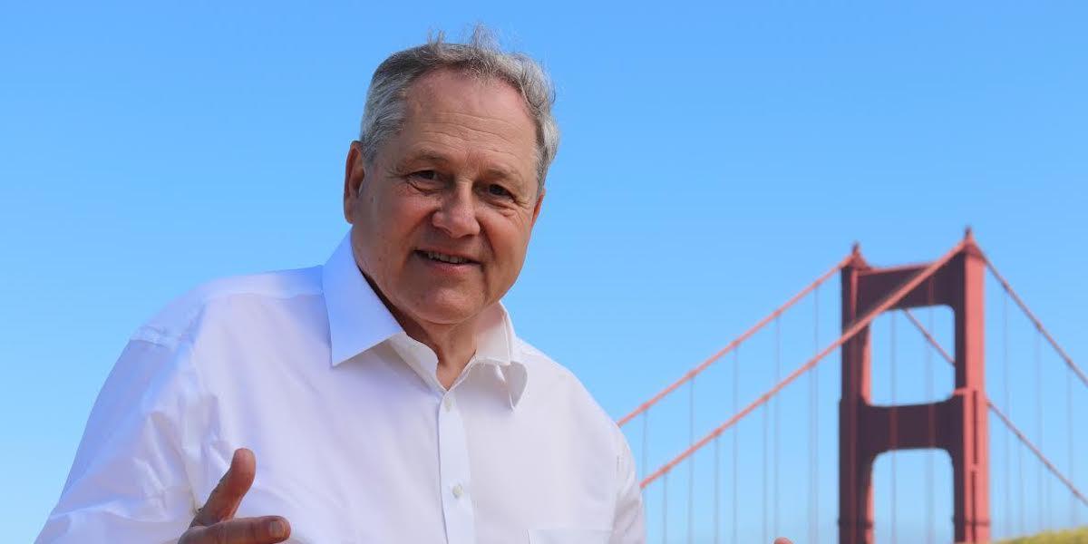 Joel Ventresca in front of the Golden Gate Bridge